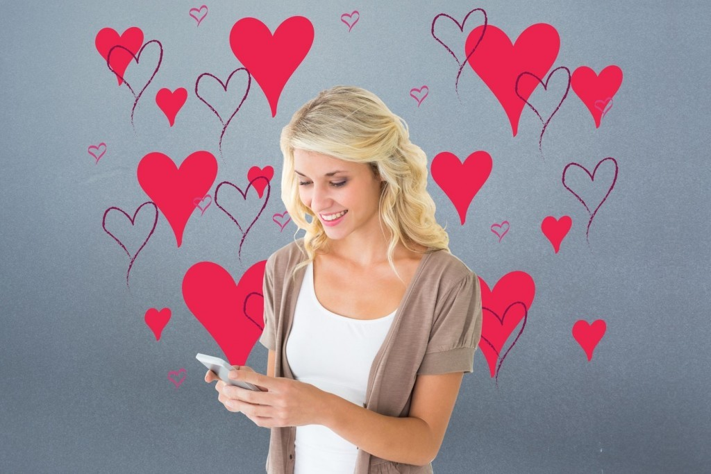 Young Woman Receiving Romantic Text Message