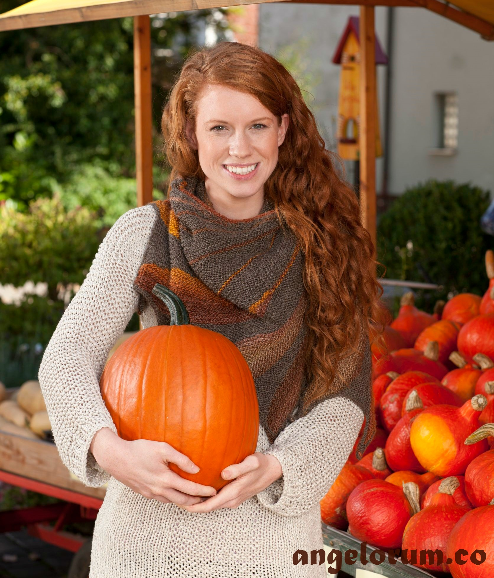 Food Affects Mood - Woman holding pumpkin